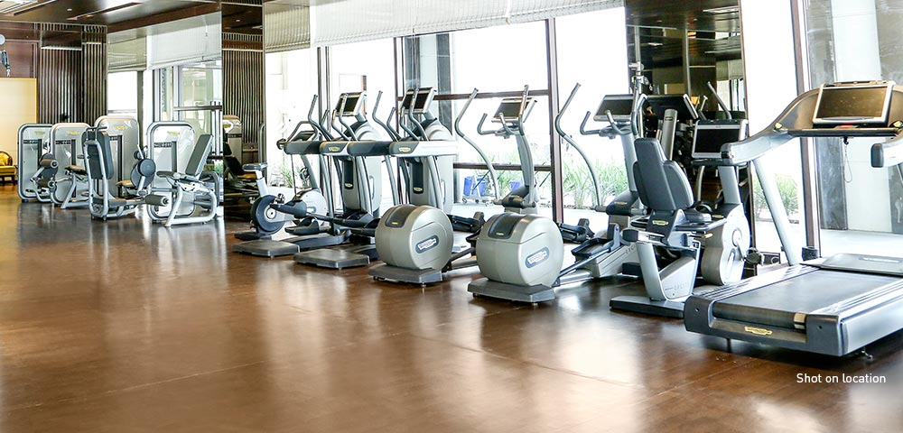Stay fit with state-of-the-art equipment and personal trainers at the private gym