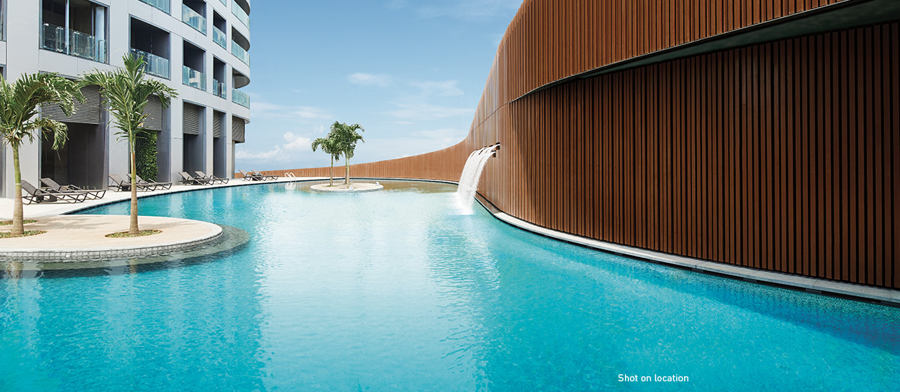 Enjoy the tropical-themed outdoor pool with islands, waterfalls and palm trees.