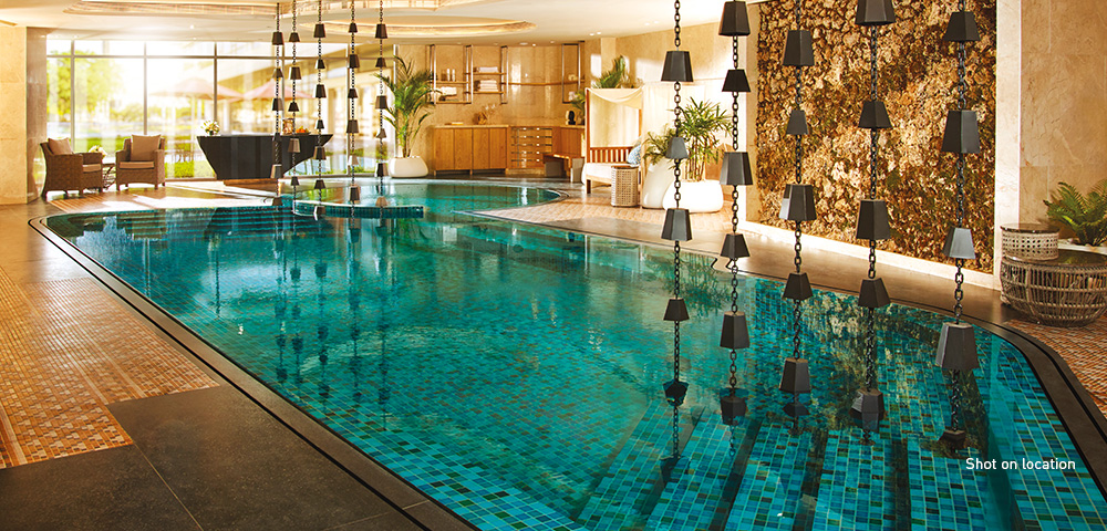 Glide through azure waters at a temperature-controlled indoor pool